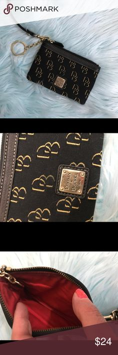Dooney & Bourke small wristlet Dooney & Bourke small wristlet. Has a key ring. In excellent new like condition. Length 6 inches, height 4 inches. Perfect for when you don't want to carry a bag. Thanks for looking! Happy Poshing! 👚👙👖 Dooney & Bourke Bags Wallets