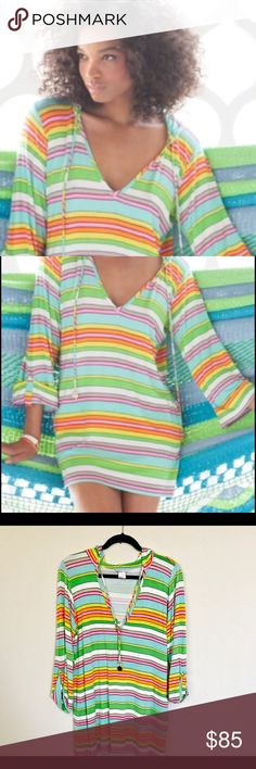 "Trina Turk ""Tennis Anyone"" Hooded Tunic Coverup Bright stripes on the Trina Turk Tennis Anyone? tunic will lighten your look and mood. * Striped jersey. * Hooded with drawstring; V neckline. * Bracelet sleeves. * Relaxed fit. * Rayon/spandex. * Imported. Condition: Gently Used some pilling Trina Turk Tops Tunics"