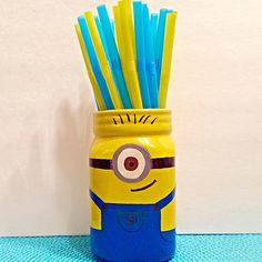 DIY-Minion Mason Jar. I painted Stuart onto a mason jar using ceramic paint & put blue & yellow straws inside.