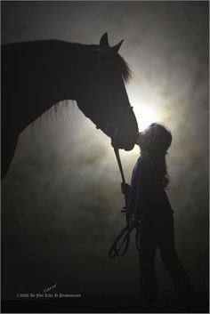 Girl and horse. Beautiful black and white horse photography with girl kissing horse silhouette lit up by the appearance of a moon or sun. Precious. Please also visit www.JustForYouPropheticArt.com for colorful art you might like to pin. Thanks for looking!