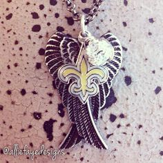 Black patina Angel Wings and New Orleans Saints football necklace by alliefayedesigns