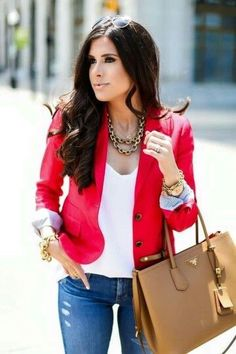 Red blazer over white tee and blue jeans.