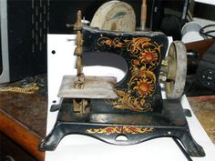 German Metal Toy Sewing Machine  100 years old
