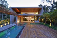 Bosque da Ribeira Residence by Anastasia Arquitetos By Magaly - Categories: Decorative Accessory, Furniture, House, Interior Design, Landscaping, Living Room, Staircase, Swimming Pool, Terrace   Add a comment