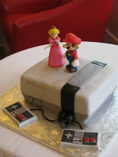 mario on nintendo entertainment system cake AWESOME!!! Totes used to play with the NES as a child