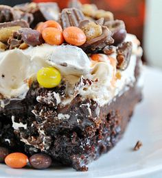 Reese's Cup Poke Cake - this Reese's  peanut butter cup poke cake recipe is to die for. The picture sells itself.