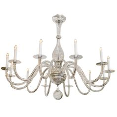 A Mid Century Murano Glass Twelve-Light Chandelier  PRICE:	$6,850 Purchase  OF THE PERIOD:	Mid-Century Modern COUNTRY:	Italy DATE OF MANUFACTURE:	c. 1950s MATERIALS:	Glass CONDITION:	Good HEIGHT:	34 in. (86 cm) DIAMETER:	46 in. (117 cm)