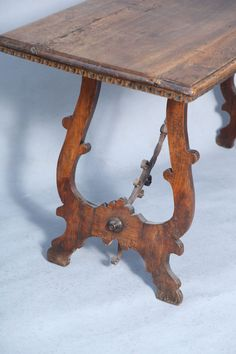 Anitque Walnut Trestle Table with Elaborate Iron Stretcher | From a unique collection of antique and modern console tables at https://www.1stdibs.com/furniture/tables/console-tables/
