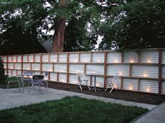 Corrugated metal and wood fence with lights - would be so cool in the back yard.