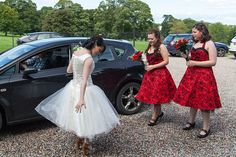 Jemma adjusts her wedding dress at her western themed wedding at the Palace Stables in Armagh