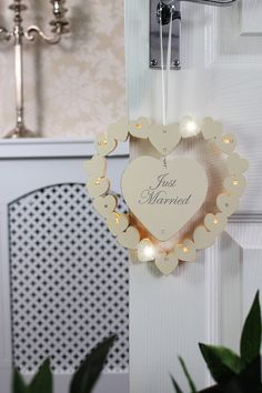 Decorate your venue our illuminated Just Married heart wedding sign, perfect for the evening. This heart shaped sign comes in cream wood, with the word Just Married written in decorative grey font. The sign is warmly lit with 10 LED lights and can b Just Married Sign, Florist Supplies, Wicker Hearts, Cinderella Wedding, Hanging Hearts, Rose Petals, Wedding Signs, Wedding Ideas, Table Centerpieces