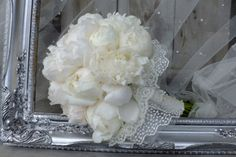 Beautiful white peonies bridal bouquet.
