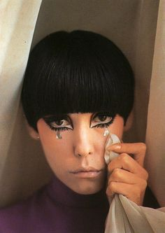 "Margaret Anne ""Peggy"" Moffitt is a former American model and actress. During the 1960s, she was muse for fashion designer Rudi Gernreich, and developed a signature style that featured heavy, Kabuki-like makeup and an asymmetrical hair cut"