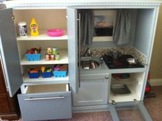 Claire's kitchen! Inside the fridge and oven of Claire's kitchen Will made her. Pinterest inspired entertainment center to play kitchen!