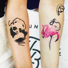 Panda and flamingo tattoos on the forearm.