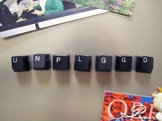 using spare keyboard parts for fridge note posting duty. Glue gun a one of those tiny super strong magnets inside a keyboard key and you can not only post things up onto the fridge, but spell out the categories or assign names.