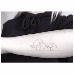 Single needle origami elephants on the left forearm.