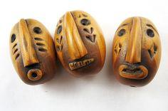 Three bearded beads by Rebecca Watkins