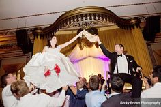 Getting lifted on chairs for the Hora can be scary, but makes a Chicago wedding photo priceless  #wedding #chicago #chicagoweddingband #chicagoband #weddingmusic #music #bko #beatmixmusic #bestweddingband