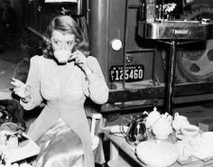 Bette Davis taking a lunch break on the set of The Bride Came C.O.D.