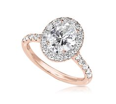 Oval Engagement Ring with Halo in Rose Gold...yep, bein that girl right now;) But I'm in love with this!