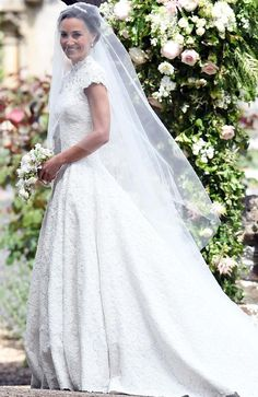 The white lace dress featured a high neck and capped sleeves showing off Pippa's toned arms. Picture: Samir Hussein/Samir Hussein/WireImage/Getty Images