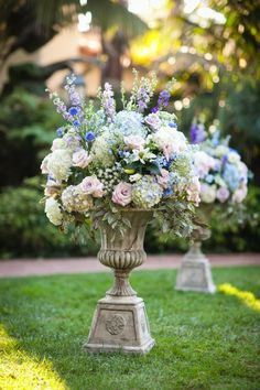 The Four Seasons Biltmore, Santa Barbara. Tall urn floral arrangements for the ceremony. This beautiful image is by Miki and Sonja Photography.