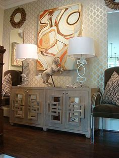 I like the design on this console table. and the art above it. and the lamps on it.