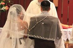 Filipino wedding tradition of veil, coins, and cord