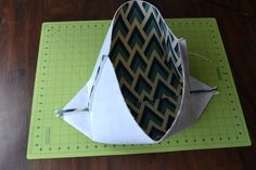 This DIY Fabric Basket Tutorial shows step by step with pictures how you can sew a fabric basket. All you need is fabric, interfacing, and cotton webbing.