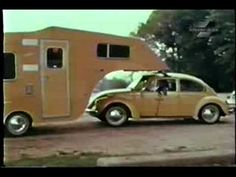A proto-type camper (circa 1970's)pulled by a vintage VW-Bug - wish they actually made this adorable camper!  It is sooo maneuverable and sleeps 4.