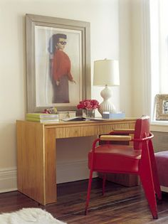 Designed by Delphine Krakoff.  I think I mainly just really like the barbie photograph above the desk. Yup.