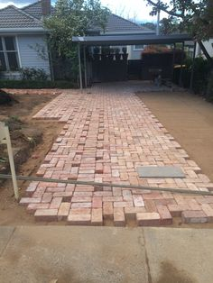 Driveway paving using old Canberra red bricks.