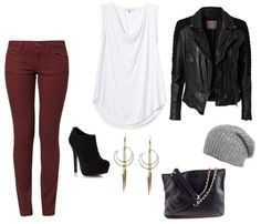Edgy outfit Idea - wine colored skinny jeans with a black leather jacket. Great outfit for a night out. Paired with spiked dangle earrings.