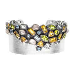 RUSTIC RAINBOW CUFF Natural citrines, moonstones, blue topaz and peridots with assorted faceted cuts and cabochons in a festive arm #cuff.