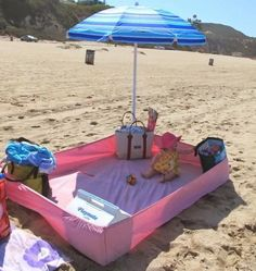 use an old fitted sheet at the beach to keep sand out