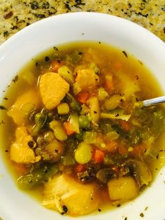 Home made chicken vegetable soup with big pieces of chicken breast a variety of vegetables in a rich chicken broth