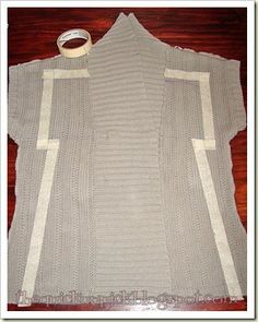 sweater upcycle- using masking tape to stabilize for sewing without pulling or bunching
