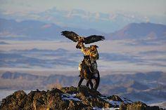Mongolian eagle hunter...you can feel her absolute joy!