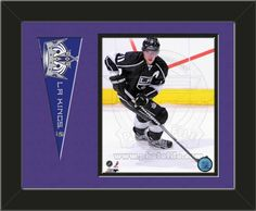 One framed 8 x 10 inch Los Angeles Kings photo of Drew Doughty with a Los Angeles Kings mini pennant, double matted in team colors to 14 x 11 inches.  (Pennant design subject to change) $59.99  @ ArtandMore.com