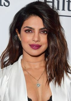 Daily Beauty Buzz: Priyanka Chopra's Magenta Lipstick and Eyeshadow | For an event before the 2018 Grammys, actress Priyanka Chopra proved the monochromatic makeup trend is far from over by debuting hot pink eyeshadow and lipstick. See the look here.