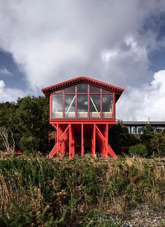 Punta Chilen by Guillermo Acuña Arquitectos Asociados is a house extension on bright red-painted pine stilts overlooking the sea on the island of Chiloe in Chile. House On Stilts, Wooden Architecture, Residential Complex, Small Places, House Extensions, Dezeen, Open Plan Living, Prefab, Picnic Table