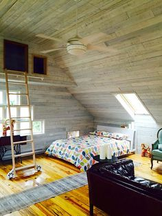 Air-conditioning and a ceiling fan for climate-controlled comfort. The loft storage space is a visual focal-point but not accessible to guests. Loft Storage, Storage Spaces, Barn Renovation, Girls Getaway, Slumber Parties, Ideal Home, Scandinavian Design, Girls Bedroom, Sweet Home