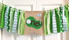 "One birthday banner ~Hole in ""one"" Golf theme high chair banner ~party banner ~cake smash ~photo prop ~ 1st Birthday ~rag tie banner by backyardprims on Etsy https://www.etsy.com/listing/292655163/one-birthday-banner-hole-in-one-golf"