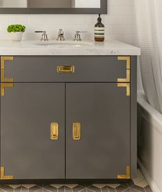 Bathroom by Grant K. Gibson at www.grantkgibson.com  Love love love the gold detailing combined with grey lacquer: unexpected but lovely!