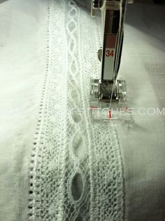 Place a piece of Stitch 'n Ditch paper (or tissue paper) behind the lace. I first stitched another narrow zig zag stitch down either side of the lace band. I then set my machine to a pin stitch and using a wing needle, I stitched down either side of the lace insertion band creating a beautiful entredeaux stitch.