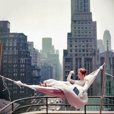 May Dancer-actress Gwen Verdon in a hammock wearing a ballgown/// Wow, what a photograph.such power and intensity, what a great fashion photo should have.and it helps to have Gwen Verdon.