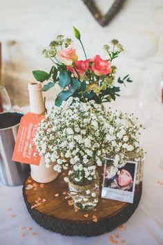 Rustic Table Centrepiece | Wooden Slab | glass jar wrapped in hessian & lace filled with gypsophila  | Rustic Wedding | Barn Wedding | Images by Ethos Photographics | http://www.rockmywedding.co.uk/becky-james-2/