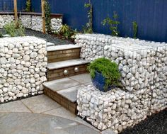 Gabion - stairs similar to ours - remove our little garden, fill with rocks?  I don't like the rock choice here