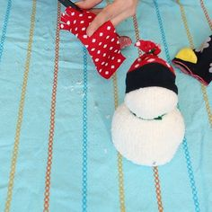 A woman cuts the ends off all of her old socks for the CUTEST reason